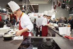 Young cooks work on their recipes at HOMI, home international show in Milan, Italy Stock Photo