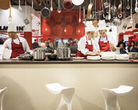 Young cooks work on their recipes at HOMI, home international show in Milan, Italy Royalty Free Stock Images