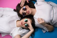Young cool attractive girls having fun. Summer time sunglasses playful Royalty Free Stock Photos