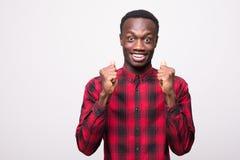 Young cool black man celebratin sign on white background Stock Photos