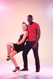 The young cool black man and white woman is dancing Royalty Free Stock Photos