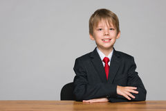 Young cool boy at the desk Stock Photos