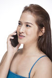 Young cool businesswoman talking on mobile phone Royalty Free Stock Photos