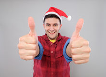 Young cool man with Santa Claus hat Royalty Free Stock Image