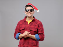 Young cool man with Santa Claus hat and sunglasses Stock Photography