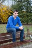 Young cool man sitting in the park Royalty Free Stock Images