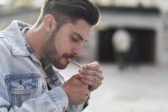 Free Young Cool Man Smoking Cigar Royalty Free Stock Image - 152561216