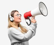 Young cool student woman with headphones stock photo