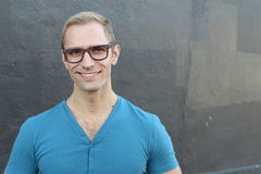 Young cool trendy man with glasses smiling Royalty Free Stock Images