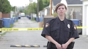 Young cop in an alley 1080p hd. Female police officer in 1080p hd stock video