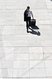 Young Corporate Man With Luggage. Walking On Pavement Royalty Free Stock Photo