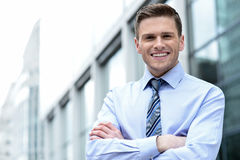 Young corporate man posing confidently Stock Photography