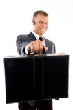 Young corporate showing his briefcase Royalty Free Stock Image