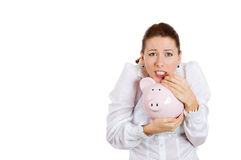 Young corporate woman possessive about her piggy bank Stock Images