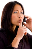 Young corporate woman talking on cell phone Stock Photography