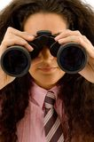 Young corporate woman viewing through binoculars Stock Photography