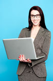 Young corporate woman working on laptop Stock Photo