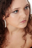 Young corpulent woman in elegant make up. Royalty Free Stock Photography