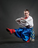Young cossack dancing Stock Images