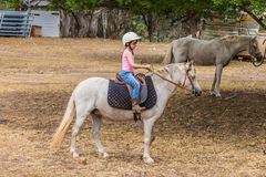 Young child learning to ride in the Upper Hunter Valley, NSW, Australia royalty free stock image