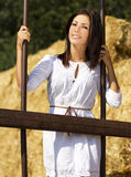 Young country girl near behind old iron bars Stock Photos