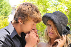 Young couple. Young man kissing a womans hand Stock Photography