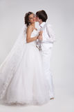 Young Couple. Young woman and man in a wedding clothing stock images