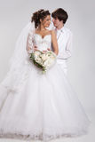 Young Couple. Young woman and man in a wedding clothing stock photos