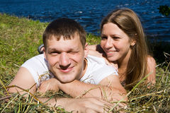 Young couple. The young couple resting on the lacke Stock Photography