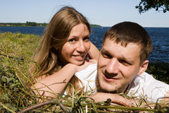 Young couple. The young couple resting on the lake Royalty Free Stock Photos