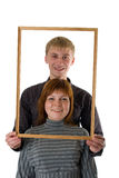 Young couple. Smiling and posing for a portrait Royalty Free Stock Photography