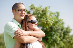 Young couple. Happy young couple hug,park outdoor royalty free stock image
