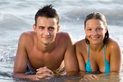 Young couple. A happy couple in the water Royalty Free Stock Images