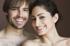 Young Couple. Posing topless front facing.  Horizontally framed shot Stock Photography