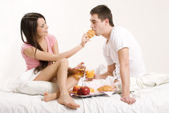 Young couple. Having breakfast in bed Stock Photos