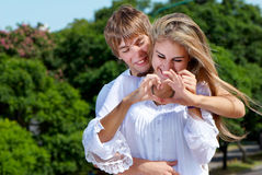 Young couple. Against the nature Royalty Free Stock Images