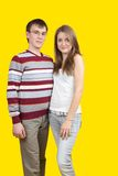 Young couple. Beautiful and cheerful young couple in light casual clothing royalty free stock photo
