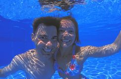 Young Couple. In Swimming Pool Stock Photo