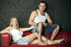 Young couple. Couple in love with the same tattoos on the feet stock photos