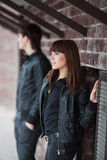 Young fashion couple flirting at the wall Stock Images
