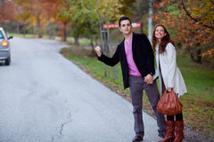 Young couple. Travelling via hitchhike Royalty Free Stock Image