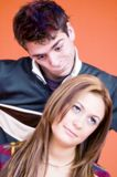 Young Couple. With silly expressions, orange background royalty free stock images