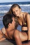 Young couple. Relaxing on the beach Royalty Free Stock Photos