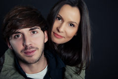 Young couple. Portrait on black background Stock Images
