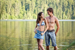 Young couple. In lake water lost in love Royalty Free Stock Photos