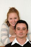 Young couple. Young man and woman smiling together Stock Images