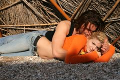 Young couple. A young blonde couple lying in a romantic pose Stock Photo