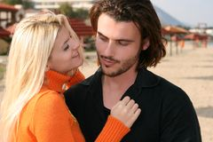 Young couple. Young blonde couple hugging each other outdoors Royalty Free Stock Photos