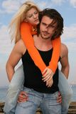 Young couple. Young blonde couple hugging each other outdoors Royalty Free Stock Photo