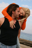 Young couple. A young couple in love hugging outdoors Stock Photos